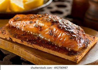 A single serving portion of delicious cedar smoked salmon.