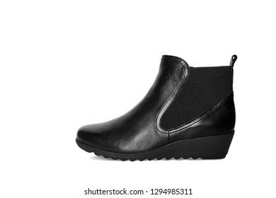 Single short black leather women's boot isolated on white background. Short demi-season shoes, fashion and shopping concept