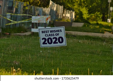 A single sign that reads 'Best Wishes Class of 2020'. The sign was placed outside the Mt Pulaski, IL high school to acknowledge the graduating seniors that will be graduating virtually.