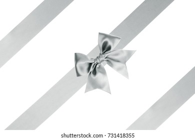 Single silver bow on a wide satin ribbon with horizontal ribbons for gifts on white background