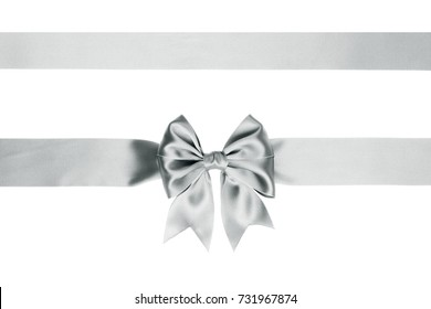 Single silver ribbon bow with tails with horizontal silk ribbon isolated on white