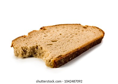 Single slice of bitten bread isolated on white background, front view, close-up
