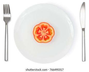 Single slice of tomato on white plate with knife and fork isolated on white background. Healthy food.
