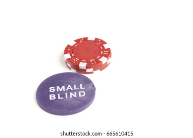 Single small stack of gaming chips behind the small blind token