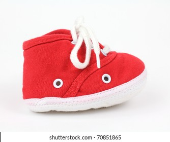A single sneaker for toddler on a white background.