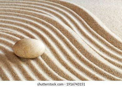 Single stone on brown  sand - Zen garden