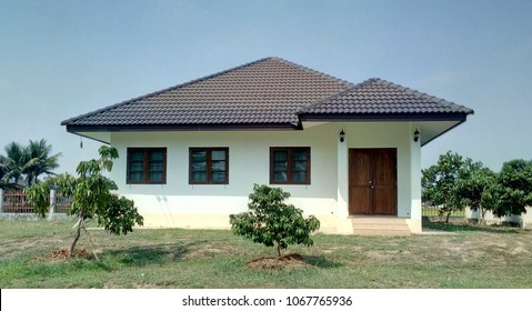 Single storey house.  Isolated single storey house. Front View of one floor single family house. Asia style design.