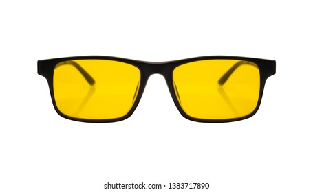 Single sunglasses with black plastic frame and yellow glass on a white background. With clipping path