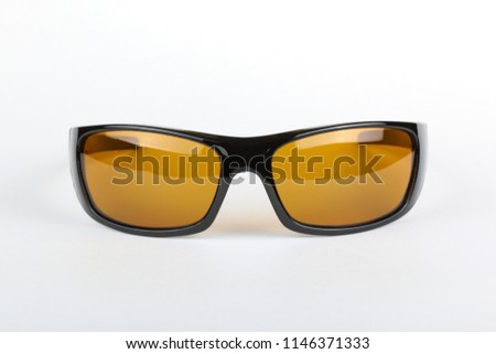 f46b823ce16 Single sunglasses with black plastic frame and yellow glass on a white  background