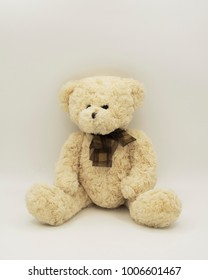 single teddy bear looking to the right sitting on the white background