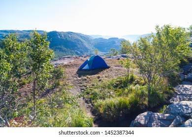 single tent placed close to the famous pulpit rock in Norway