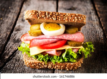 Single toast sandwich on the wooden background