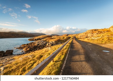 A single track road called the Golden Road popular with tourists as a scenic driving route on the Isle Of Harris in the Western Isles of Scotland