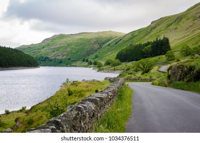Single track road running alongside Haweswater Reservoir in Cumbria.