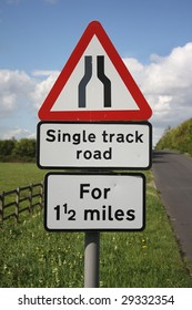 Single track road sign in rural location.