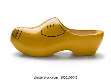 Single traditional yellow Dutch wooden shoe on white background