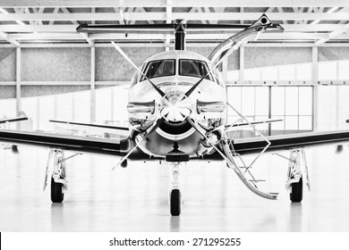 Single turboprop aircraft in hangar.