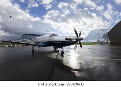 Single turboprop aircraft Pilatus PC-12 in hangar. Stans, Switzerland, 29th November 2010