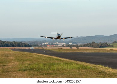 Single turboprop aircraft take-off aircraft. Single-propeller aircraft flying over the runway at a small airport