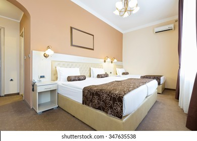 Single and twin bed in hotel room