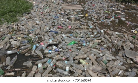 Single use, disposable plastic soda bottles were thrown as garbage to the water, Ateret, Israel, August 19th, 2017.