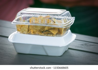 Single use plastic and Styrofoam food containers ready for take out from a restaurant.