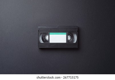 Single VHS Cassette in the center of the image with copy space for text or other design