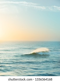 A single wave on the ocean beautiful colors at sunset single wave on the ocean beautiful colors at sunset