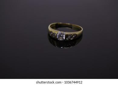 single wedding ring isolated on dark background