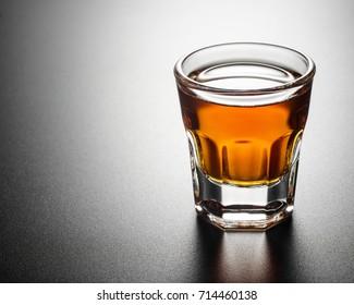 Single whisky shots on black