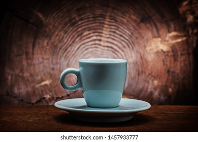 single white ceramic coffee cup on saucer vitage wood cross sected background