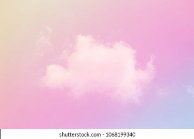 Single white cloud on pastel colored backround