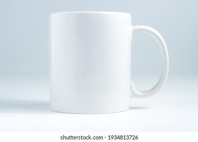 single white plain mug isolated in white background