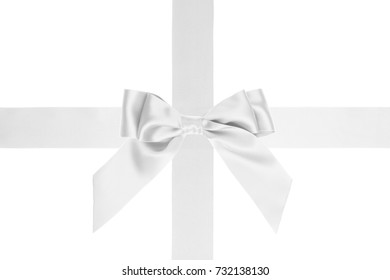 Single white silk bow with tails on wide cross ribbon on white background