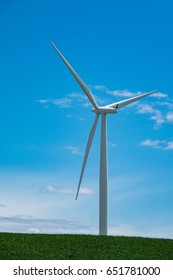 Single white wind turbine rising in a blue sky