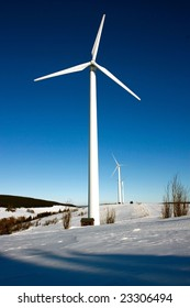 single wind mill and snow