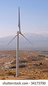 single wind turbine in the desert