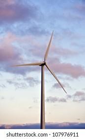 Single Wind Turbine on Afternoon Near Sunset Sky. Green Energy Technologies.