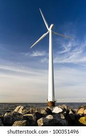 Single windmill on the rocks