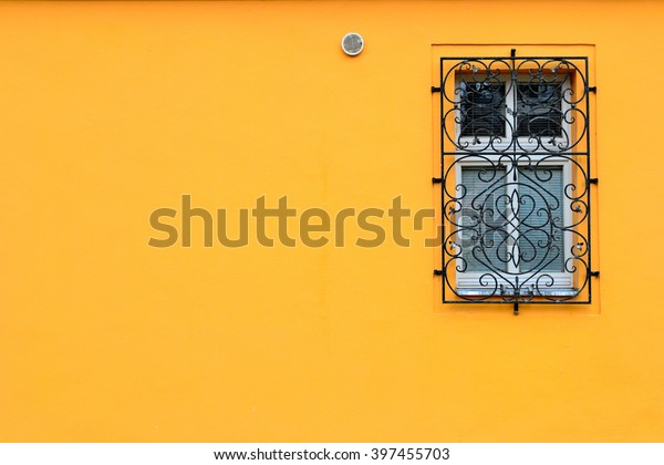 Single window on a orange wall with room for copy or text.
