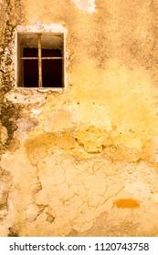 A single window on a ruined wall.