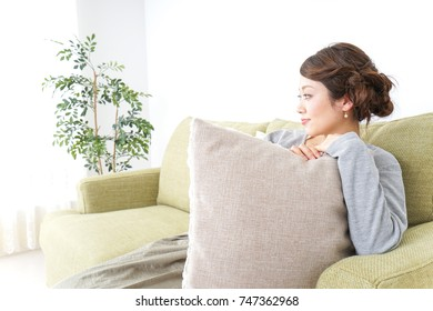 single woman being relaxed at home