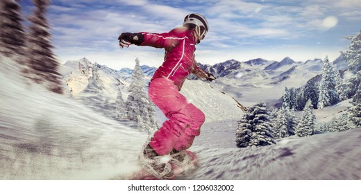 single woman on snowboard slides through a curve down the hill with high speed. powder snow flying behind her.