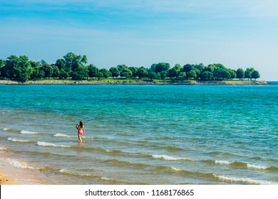 Single Woman Swimming at 57th Street Beach in Chicago