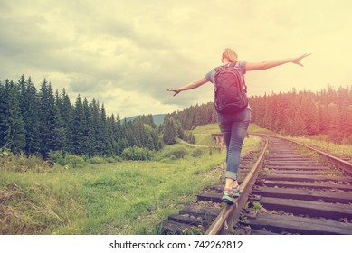 single woman traveler walk on railways