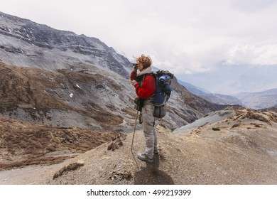 Single woman traveller on the trail in the Himalaya mountains, Nepal.