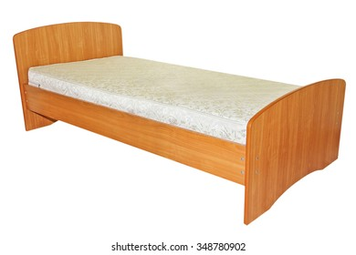 Single wooden bed taken closeup isolated on white background.
