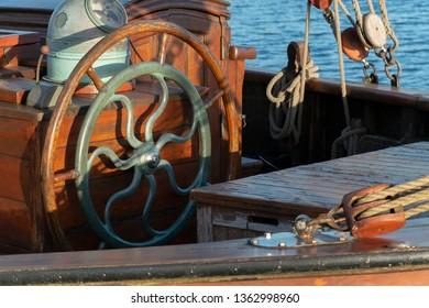 Single wooden steering wheel at an ancient sailing boat