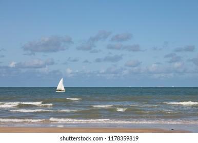 Single yacht sailing in a blue sea