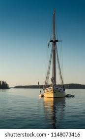 Single Yellow Hulled Sailboat - Maine, USA